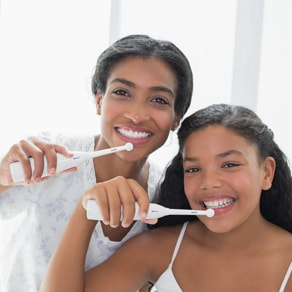 Women brushing their teeth